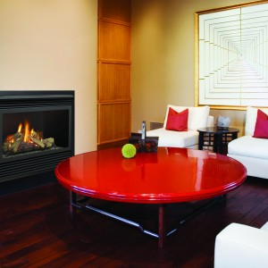 ca. 2006 --- Red Coffee Table in Front of Fireplace in Contemporary Home --- Image by © Royalty-Free/Corbis